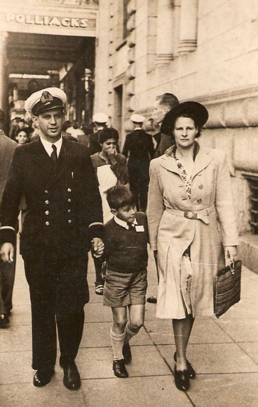 Sub-Lieutenant Murray McGregor walking in Adderley Street, Cape Town, with his wife Margery and first child Christopher. 1943
