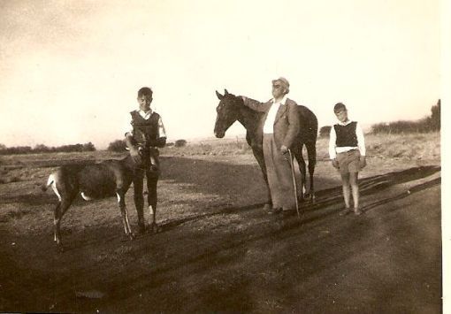 Alex Kirstein with one of his horses. The young men are Chris McGregor on the left and I think Jan Kirstein on the right